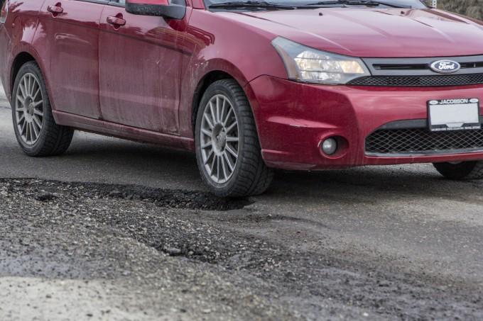 repairing pothole damage